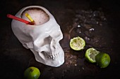 A zombie cocktail served in a skull