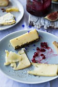 A cheese dish with cranberry jam