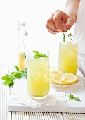 Apple and lemon lemonade with a mint decoration