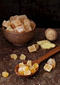 Candied ginger in a bowl and on a wooden spoon