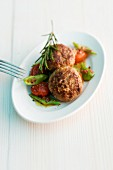 Lamb meatballs with rosemary, beans and tomatoes