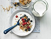 Crispy muesli with thick milk and berries