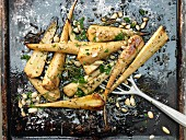 Baked parsnips with almonds and rosemary