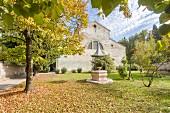 The monastery church and courtyard of the Eremo San Giorgio, Bardolino, Italy