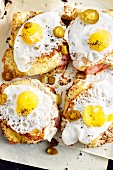 Spicy croque-monsieurs topped with a fried egg (soul food)