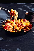 Pasta bake with melted cheese served in the pan (soul food)