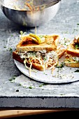 A smoked trout fillet and coleslaw sandwich (soul food)