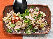 Pasta salad with tuna, dried tomatoes and rocket in a citrus vinaigrette