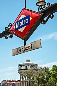 The water tower and Metro sign in front of the Matadero cultural centre in Madrid, Spain