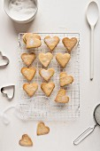 Heart-shaped butter biscuits coated in sugar on a cooling rack