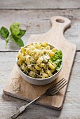 A bowl of pasta with basil pesto