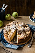 Apple cake with walnuts and oats crumble topping, slive removed
