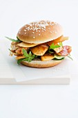 A chicken burger on a white background