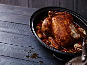 Roast chicken in an oven dish