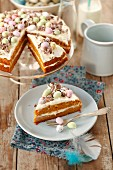 Carrot cake with orange cream and chocolate eggs for Easter
