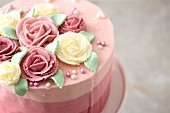 Striped ombre cake decorated with buttercream roses
