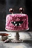 A pink 'Monster Alarm' buttercream cake