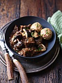 Venison goulash with mushrooms and dumplings