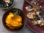 Pumpkin puree with fried mushrooms and pumpkin pesto