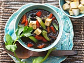 Black bean soup with peppers and vegetables