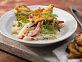 Pilz-Piccata in Parmesan-Eimantel, auf einem Ragout von Kohlrabi mit Tomaten und Kräutern