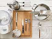 Kitchen utensils for making spicy dumplings with a vegetable salad