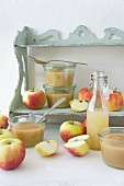 Apples, apple sauce, and apple juice on a shelf