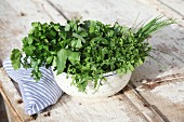 Fresh spring herbs in a bowl