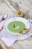 Cream soup with herbs and puff pastry whirls