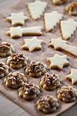 Butter cookies with walnuts on baking paper