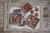 Chocolate 'bear claw' biscuits with flaked almonds