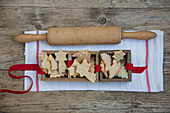 Gingerbread biscuits in wooden boxes with a rolling pin