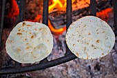 Tortillas on a fire grate