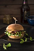 Vegeterian burger with mushrooms, pea shoots, pesto, onions and mature chedar cheese