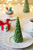 Christmas place settings with mini Christmas trees
