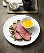Roast beef with chard sauce and pumpkin mash