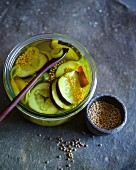Sweet and sour cucumber slices pickled in white wine vinegar with mustard seeds