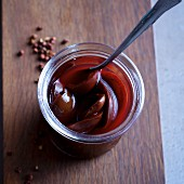 Balsamic plums with ginger and Sichuan pepper in a preserving jar