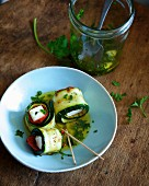 Grilled courgette and feta rolls preserved in olive oil