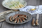 Nuremberg sausages with asparagus salad