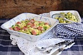 Creamed savoy cabbage with sausage dumplings and parsley potatoes