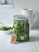 Preserved green vegetables in a storage jar