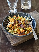 Vegan vegetable salad with chickpeas and fermented swede