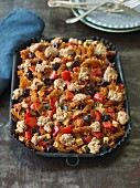 Vegan pasta bake with chopped tomatoes and black olives