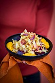 Ribbon noodles with pumpkin puree, red beetroot and red onions