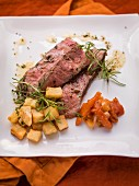 A beef steak with herb butter and vegetables