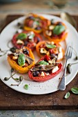 Stuffed pepper halves with anchovies, olives and capers