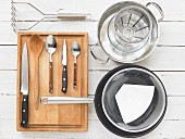 Kitchen utensils for making potato biscuits with mushroom sauce