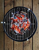 Small bbq on wooden floor