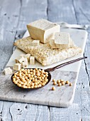 Tofu and soya beans on a marble board